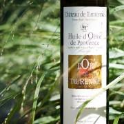Visuel-bouteille entourée d'herbes